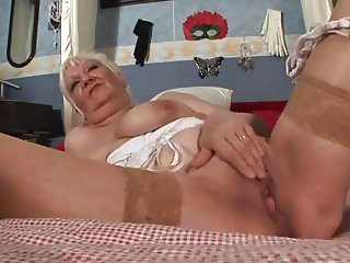 Tattooed Granny Toys Her Meaty Pussy