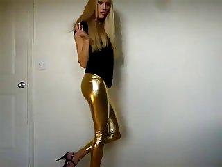 Stunning blonde teasing in gold latex