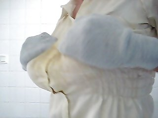 In a satin blouse I stroke my big tits.
