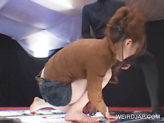 Redhead asian shows undies upskirt