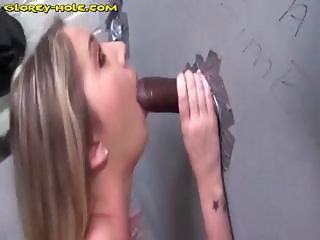 Blonde eats a black cock through a glory hole and then fucks it