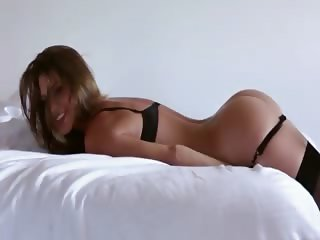 Superb big juggs hottie Amber Sym in stockings teasing on the bed
