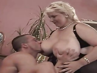 A classic blonde Shorthair BBW Milf by young Guy