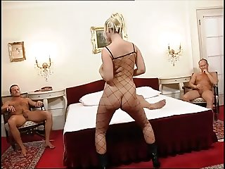 Short haired blonde in black boots and body stocking