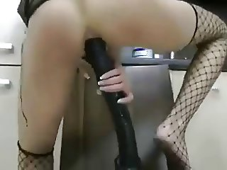 Sexy Chick taking large dildo in Ass