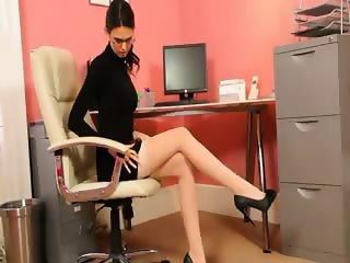 Secretary in sexy black heels stripping