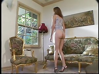 Beautiful Gwen in the parlor waiting to tease you