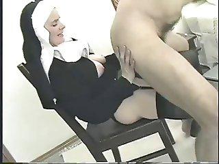 Nun and strapon