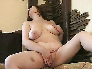 Chubby brunette shows ass