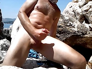 Playing with big cock and ass hole on the beach