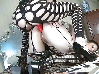 British slut Samantha fucked with a strap on