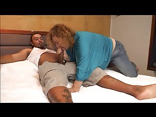 Mature transsexual with curly hair blows and get fucked from behind