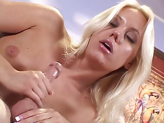 Blonde gets her hand around a thick cock and jerks it hard