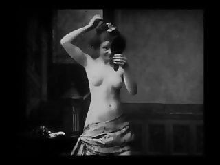 Vintage Erotic Movie 6 Seminude Woman combing Hairs 1905