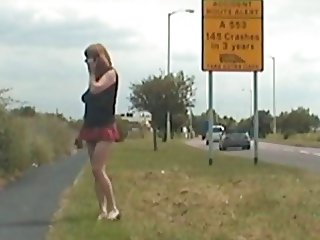 Lovely tranny flashes her pretty cock on a busy maIn road