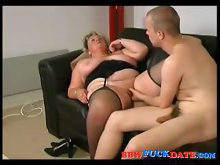 Busty blonde mature BBW gives this young guy head and swallows