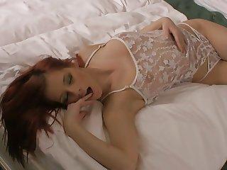 Ariel Piper Fawn masturbating on bed.