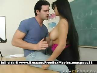 Busty brunette teacher on the desk