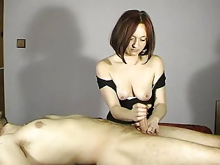 She wanks her man and gets her tits out too