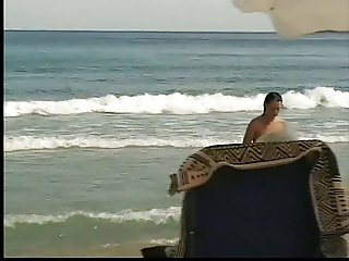 wife exposing on beach