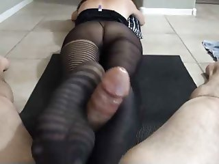 wonderful milf is giving a hot footjob