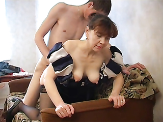 Russian granny Elizabeth in stockings is getting nailed by her young lover