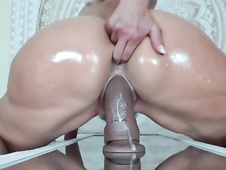 Big ass housewife is jumping on big dildo like a crazy